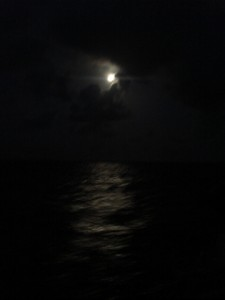 A night sail under a full moon