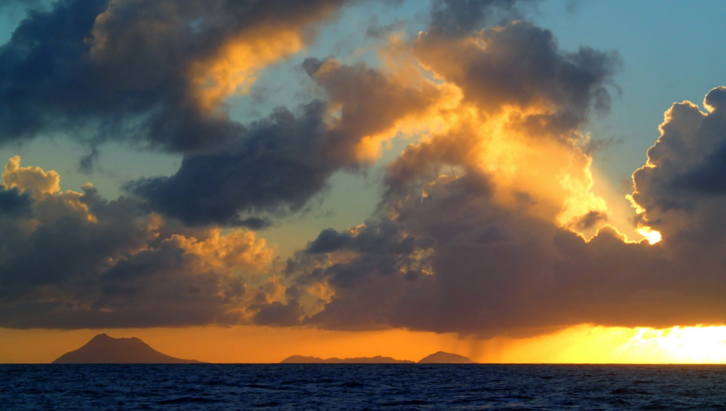 Sun setting over St Kitts and Nevis on the way to Antigua
